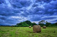 Hay Bales In A Storm Sky.