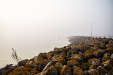 Sunrise And A Stone Pier A Misty Morning At East Side Of Gotland