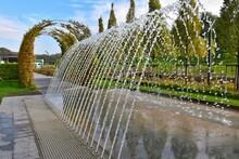 "Beautiful Cascade Fountain In New Fentezi-Park ""Nova Sofiyivka"", Uman Ukraine. Fountain Above The Footpath In The Park. Row Of Water Jets"