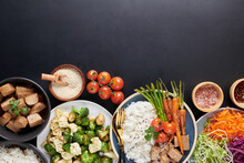 Healthy Organic Tofu And Rice Buddha Bowl With Veggies. Poke Bowl With Silken Tofu, Rice And Mixed Vegetables, Carrots, Asparagus, Tomatoes, Beans . Healthy Vegetarian Salad Bowl.