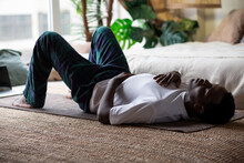 African Adult Man Relax After Working Out Breathing.
