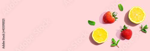 Fototapeta Fresh lemons and strawberries with mints