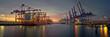 Leinwandbild Motiv container terminal in the evening in hamburg harbor
