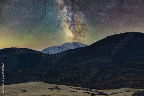 Superb shot of colorful Milky Way glowing in the sky seen through moutains