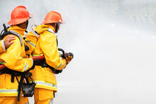 Firefighters Train Firefighters To Use Water And Fire Extinguishers To Fight Flames In Emergency Situations.Under Dangerous Situations, All Firefighters Wear A Firefighter's Clothing For Safety.