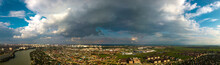 Thundercloud Over The River And Low-rise Area In The Suburbs Of Krasnodar On A Sunny Spring Day