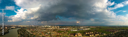Fotografie, Obraz thundercloud over the river and low-rise area in the suburbs of Krasnodar on a s