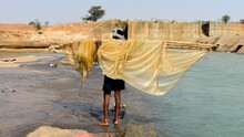 A Man Going For Fishing In River Using Small Dragnet In Surajpur, Chhattisharh, India
