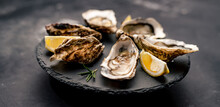 Oysters With Lemon On Platter
