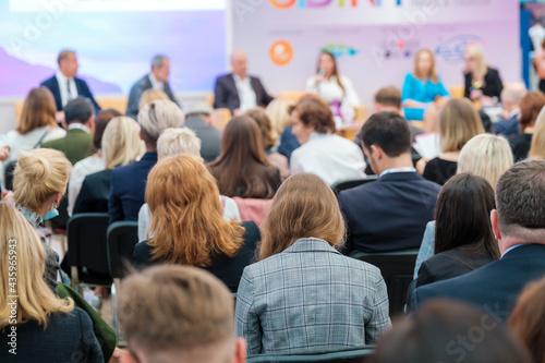 Speakers discussing business problems in auditorium #435965943