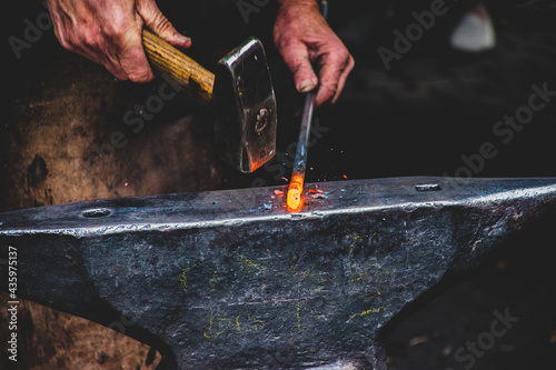Tela Person working with a hammer