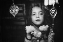 Portrait Of Cute Girl Holding Toys