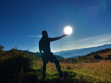 Man Standing On Field Against Bright Sun
