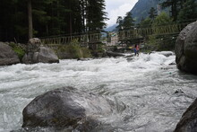 A Picture Of The Beautiful Beas River Flowing Through The Himalayan Mountains In Manali, Cutting Through Forests And Rocks.