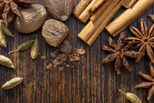 Various Cooking Spices, Anise, Cardamom, Nutmeg, Cinnamon On  Brown Table. Spices Set.