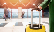 Concept Banner Airplane Travel Woman In Green Coat Holds Passport With Ticket And Yellow Suitcase Airport