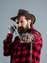 Portrait Of Masculinity. Male Casual Fashion Style. Handsome Hipster With Cowboy Hat Hold Chain