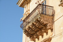 Palazzo Nicolaci Is One Of The Main Examples Of Sicilian Baroque. The Balconies With Curved Iron Railings, Corbels In Carved Stone With Grotesque Figures.