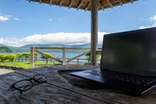 湖畔のテラスでのテレワーク イメージ lakeside Terrace  With PC And Glasses
