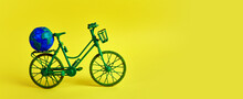 3rd June World Bicycle Day. Green Bicycle On Yellow Background. Environment Preserve.