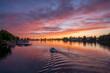 Sonnenuntergang am Bodensee in Lindau mit einem Boota