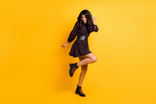 Full Body Photo Of Pretty Excited Dark Skin Person Raise Knee Have Good Mood Isolated On Yellow Color Background