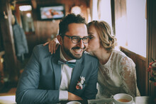 Stylish Bridal Couple In A Cafe, Happy Bride And Groom Together