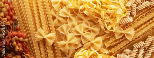 Fotografiet Assorted varieties of pasta background. Mix macaroni