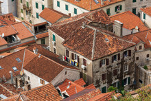 Close-up Top View Of The Old Roofs With Red Tile, The Old Town Of Kotor In Montenegro