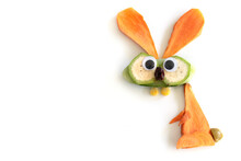Food Art Creative Concepts. Funny Bunny Rabbit Made Of Fruits And Vegetables, Such As Carrots And Cucumber Isolated On A White Background.