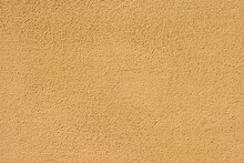 Plaster On A Yellow Wall. Concrete Wall Texture Close Up.