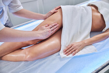 Professional Masseur Doing Lymphatic Drainage For Young Woman In Cabinet