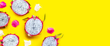 Dragon Fruit Or Pitaya With Bougainvillea Flowers On Yellow Background.
