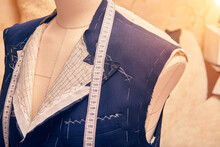 Semi-ready Jacket On Mannequin With Measuring Tape Across Neck. Suit Tailoring In Process Of Custom-made Jacket. Bespoke Suit Tailoring In Tailor Workshop. Working On A Made-to-measure Suit Jacket