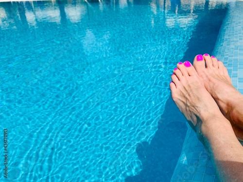 Fototapeta feet in swimming pool beautiful woman