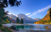 Landscape Of Golden Orange And Red Colors Of Autumn Alps Slovenia Italy Low Clouds And First Snow Bright Sunny Day
