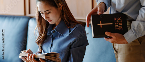 Fotografie, Obraz Close up woman holding Read and chant the Bible