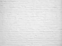 Old Brick Wall Painted With White Paint.