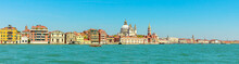 Panorama Of San Marco Bell Tower In San Marco Square In Venice With Saint Mark Basilica Of The Famous Venetian City Of Italy. Sea View From Giudecca Canal By Cruise Boat Trip In Venetian Lagoon.