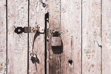 Old Wooden Doors With Lock. Weathered Texture Background.