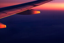 Beautiful Colorful Sunset Or Sunrise View From Airplane Window On The Wing
