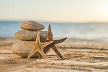 Blue Sea On Background Selective Focus, Zen Stones On Sea Beach, Meditation, Spa, Harmony, Calm, Balance Concept