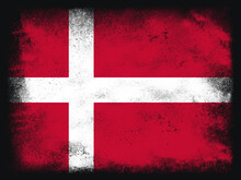 Denmark Flag Design Composition Of Exploding Powder And Paint, Isolated On A Black Background For Copy Space. Colorful Abstract Dust Particles Explosion. Euro 2020 Football Symbol For Printing