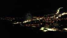 Aerial Panning Scenic View Of Fireworks In City During Winter - British Columbia, Canada
