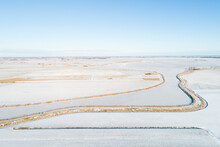Netherlands, Broek, Aerial View Of Snow Covered Fields And Canal