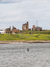 Tynemouth Priory And Coast Guard Station With Paddle Boarder