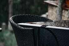 Chair And Table Under Rain