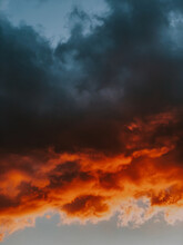 Vertical Shot Of Breathtaking Orange And Black Clouds During Sunset - Great For Background