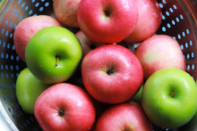 Top View Of Washed Red And Green Apples In A Basket, They Still Look Wet.