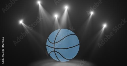 Composition of blue basketball over spot lights on grey background